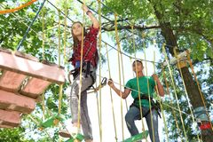 Children climbing in adventure park. Summer camp. Children climbing in adventure park outdoors. Summer camp royalty free stock image