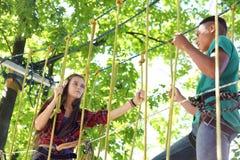 Children climbing in adventure park. Summer camp royalty free stock photo