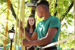 Children climbing in adventure park. Summer camp stock photos