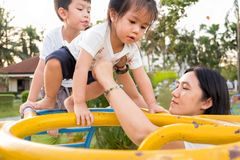 Children are climbing the high yellow ladder at playground on a Royalty Free Stock Photography