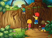 Children climbing up the ladder in the woods Stock Images