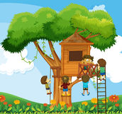 Children climbing up the treehouse in the garden Stock Images