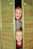 Children from closet royalty free stock photo