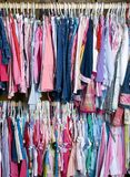 Children Clothes 02. A young girls closet is stuffed full of colorful summer wear Stock Photo