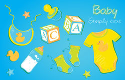 Children clothes 1. Children clothes on a blue background baby pacifier nipple cubes socks toy duck clothing Royalty Free Stock Image