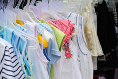 Children  clothes. Colorful children  clothes in the shop Stock Photo