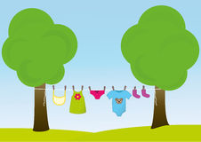 Children clothes on the clothesline Royalty Free Stock Images