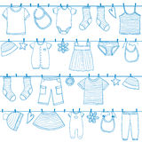 Children clothes on clothesline Stock Images