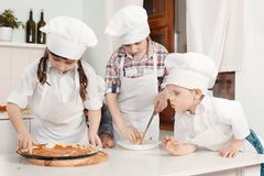Children in clothes cooks Royalty Free Stock Photography