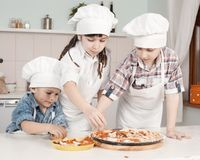 Children in clothes cooks Royalty Free Stock Photo