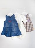 Children clothes on racks Royalty Free Stock Photo