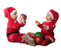 Children in the clothes of Santa Claus Stock Photos