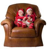 Children in the clothes of Santa Claus. Royalty Free Stock Photos