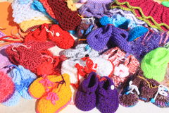 Children clothing accessories. Crochet colored bootees handmade Stock Image