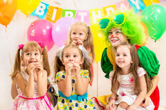 Children and clown on birthday party Stock Photo