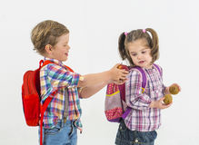 Children with clubs play with fruits stock photos