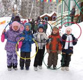 Children with color olympic rings in kindergarten, Russia. Children with color olympic rings in kindergarten outdoor, Russia Stock Photography