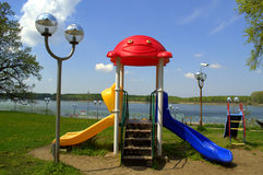 Children colorful playground riverside park stock image