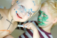 Children Coloring Their Faces with Markers Royalty Free Stock Image