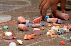 Children and coloured chalks stock photos