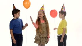 Children come to the birthday party and play stock video