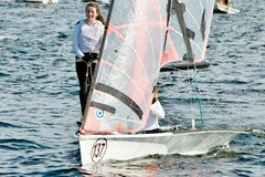 Children sailing competition in dinghies. royalty free stock photography