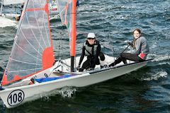 Children sailing competition in dinghies. stock image