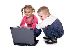 Children and computer. Children learning or playing computer games royalty free stock image