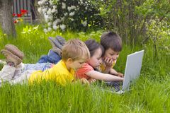 Children with computer Royalty Free Stock Photos