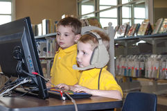 Young boys using a computer Royalty Free Stock Image