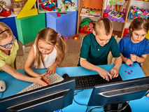Children computer class us for education and video game. Boys and girls in children`s club who spend many hours behind computer monitor harmful to health Royalty Free Stock Photo