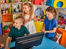 Children computer class us for education and video game. Boys and girls in children`s club who spend many hours behind computer monitor harmful to health Royalty Free Stock Image