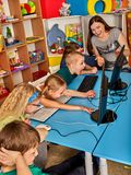 Children computer class us for education and video game. Boys and girls in children`s club developing computer games. New technologies alternative to classical Royalty Free Stock Images