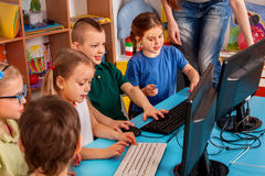 Children computer class us for education and video game. Kids boy and girl play and learn on computer. Simulator for training keyboard Royalty Free Stock Photography