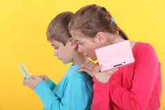 Children with computer games stock photos