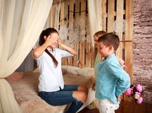 Children congratulate mother give her bouquet of flowers Stock Photography