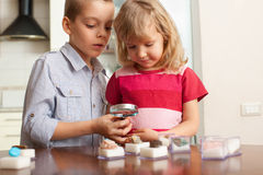 Children are considering a magnifying glass stones Royalty Free Stock Images