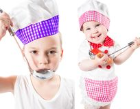 Children cook boy and girl wearing a chef hat with  pan isolated on white background. The concept of healthy food and childhood Stock Photos