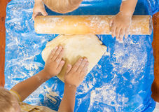 Children cook dough for a pie Stock Photos