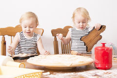 Children cook. Children enthusiastically help in the kitchen to cook Royalty Free Stock Image