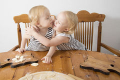 Children cook. Children enthusiastically help in the kitchen to cook Royalty Free Stock Images