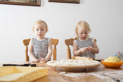 Children cook. Children enthusiastically help in the kitchen to cook Stock Image