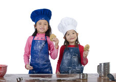Children Cooking. Children having fun cooking by themselves for the first time Royalty Free Stock Photos
