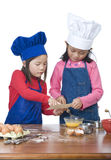 Children Cooking. Children having fun cooking by themselves for the first time Stock Images
