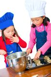 Children Cooking. Children having fun cooking by themselves for the first time Royalty Free Stock Photo