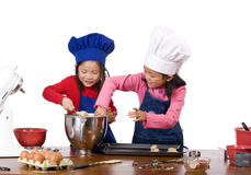Children Cooking. Children having fun cooking by themselves for the first time Royalty Free Stock Photography