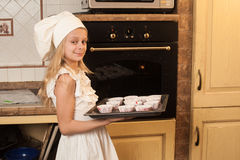 Children cooking Christmas cakes Stock Image