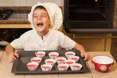 Children cooking Christmas cakes Royalty Free Stock Images