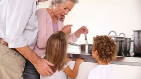 Children cooking with grandparents Royalty Free Stock Images