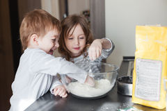 Children cooking holiday pie Stock Photos